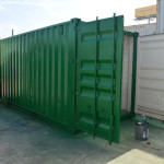shipping_container_painted_green_living_storage_sanded